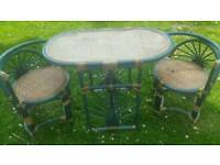 Bamboo/wicker conservatory table with tuck under chairs..strong and steardy. Needs a tidy up..