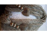 Scarf with heart embellishments