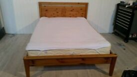 doubel bed solid oak frame good condition very strong sterdy bed