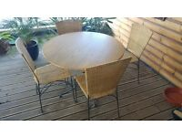Wood top, metal frame Dining / kitchen / conservatory table and wicker-on-metal frame chairs.
