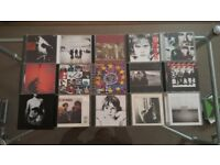 Collection of U2 CDs for sale.