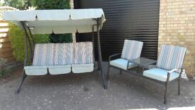 Three Seater Garden Swing and matching Double Seat with a Glass Table