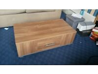 Small coffee table with storage in very good condition, less than a year old