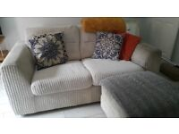 Cream two seater sofa with storage footstool