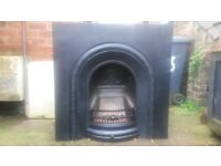 LARGE CAST IRON FIREPLACE IN EXCELLENT CONDITION.