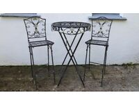 Wrought iron fold-away indoor / outdoor table and 2 chairs
