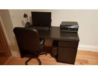 OFFICE DESK..black...MALM IKEA . Goode condition with hidden shelf for computer leads
