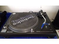 Pair of Technic 1210 mk3 turntables, with lids. In very good condition