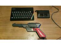 ZX Spectrum with light gun and stack of games