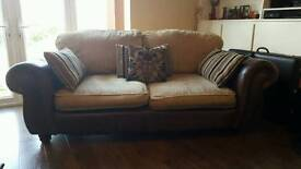 3 seater brown leather/fabric sofa.