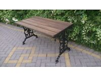 CAST IRON TABLE IN METALLIC BLACK FOR A GARDEN, PATIO OR CONSERVATORY