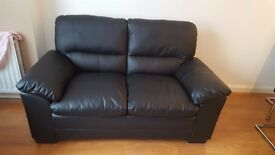 black 2 seater sofa for sale in excellent condition extremely comfortable only 10 months old