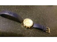 £180 = Desinger watch & sunglasses