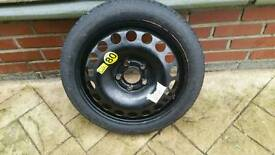 Space saver wheel 5 stud from a 2008 VAUXHALL ASTRA.