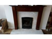 Coal effect gas fire, marble hearth/back, wooden mantlepiece