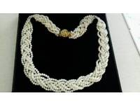 1,000 pearl twisted necklace.