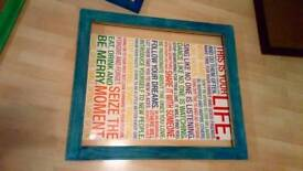 Large poster in painted wooden frame