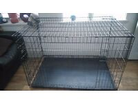 Large dog cage it fits about 2 dogs in my huskey and akita fitted in it both of them good condition