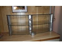 Glass oval tv stand.