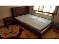 Double bed with mattress, headboard, side table and drawer. Dark brown faux leather good condition
