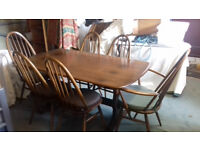 ERCOL REFECTORY TABLE PLUS 6 ERCOL DINING CHAIRS, 2 CARVERS PLUS 4 DINING CHAIRS ALL IN GOLDEN DAWN