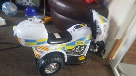 Childs battery powered police trike