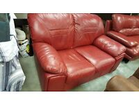 Beautiful Red Two-seater Sofa with Wooden Legs in Great Condition