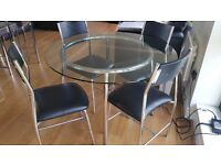 Glass dining room table & 4 chairs