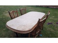 Solid oak table and 4 chairs.