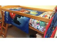 Mid sleeper single pine bed frame with matching bedroom furniture pieces.