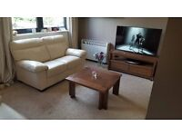 Harveys Cream Leather Sofas x2. Also being sold separately.