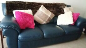 2 matching dark blue leather settees. One 2 seater one 3 seater