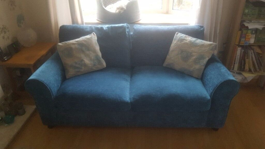 Two Sofas- 1 x 3 seater, 1 x 2 seater sofabed. Great condition, 6 accent cushion covers. C