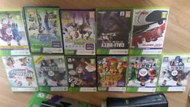 Xbox 360 with kinnect and wireless controllers and numerous games original packaging 3 years old