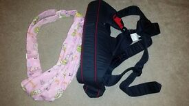 2 baby carriers, one baby bjorn and one easy over the shoulder sling £7 ono