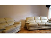 Two & Three Seater cream leather suite in good condition