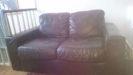 Black or very dark chocolate brown 2 seater leather sofa