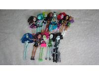 A Dozen Monster High Dolls
