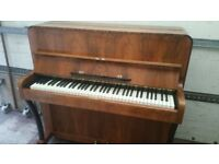 Upright piano very ornate and small