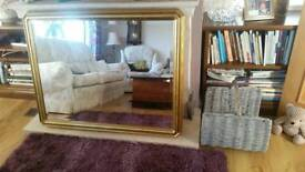 large bevelled wall mirror.