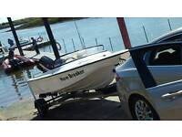 Speed boat, fishing, water ski set up.