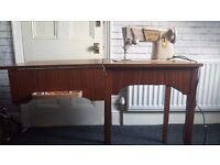 vintage electric sewing machine with table.