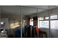 Floor to ceiling mirrored sliding doors with runners