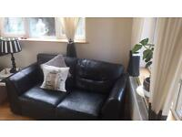 Leather two seater sofa bed including matching arm chair