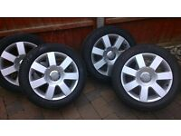 four Audi alloys with tyres in good condition