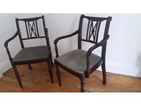 2 dark wood vintage dining chairs
