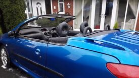 Blue Peugeot 206 convertible. Alloy wheels and leather interior