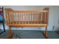 Lovely Swinging Crib - in excellent condition.