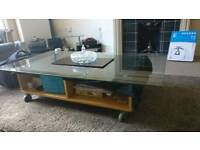 Glass top tea table with storage space