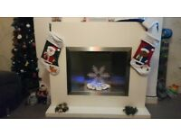 Fire surround with heater